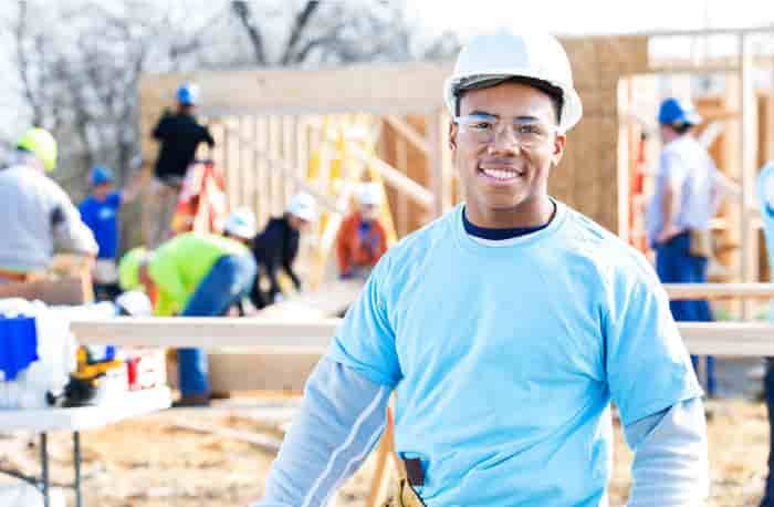 Man smiling on a home development construction site